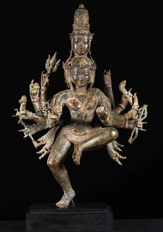 "Brass Dancing 5 Faced Shiva Statue 27"" This stunning statue of Shiva depicts him in a very rare form with 5 faces and 10 arms in ecstatic dance. Each of the faces has a name and represents a specific aspect. These five faces are Isana, Tatpurusa, Aghora, Vamadeva and Sadyojata. Isana faces south east and represents Iswara aspect of Shiva known as SadaShiva, or the Eternal Shiva."