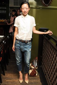 Tomoko Ogura: boyfriend jeans, white button down, nude heels