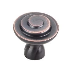 This brushed oil rubbed bronze finish round cabinet knob with swirl design is a part of the Duval Series from Jeffrey Alexander. A perfect blend of craftmanship in traditional and contemporary design to complement any decor.