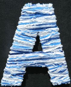 Yarn-covered wooden letter is a craft anyone can do.  Perfect decoration for a kid's door or wall.
