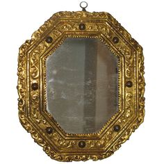 A Rare Gilt Copper Repousśe Octagonal Mirror with Inset Hard Stones | From a unique collection of antique and modern wall mirrors at http://www.1stdibs.com/furniture/mirrors/wall-mirrors/