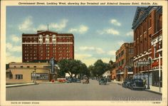 Mobile AL Government Street, Looking West, Showing Bus Terminal and Admiral Semmes Hotel Admiral Semmes Hotel and Bus Terminal are both new and modern buildings facing Government Street which is a part of the old Spanish trail. Both buildings are located within two blocks of the entrance of Bankhead Tunnel, which passes under Mobile River