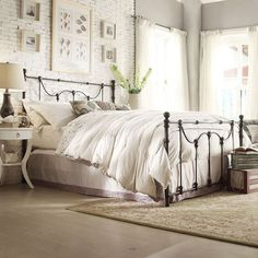 Oh heavenly bed! Light and fresh master bedroom. Interior brick and antique-look bed frame.