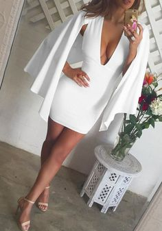 For a classy look, wear this beautiful white cape dress with strappy heels or pumps.