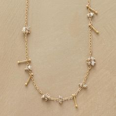 """DIAMOND PINS NECKLACE--Sarah McGuire pins raw diamond beads randomly along a 14kt gold chain. Unadorned pins add movement, threaded through links to shift this way and that. Hook clasp. Handcrafted in USA. 20""""L."""