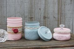Shabby chic mason jar dresser or bathroom set. Hand painted in soft pink, lightly distressed, wrapped with burlap, seed pearl trim, lace and roses, finished with a protective coating. The lids and ban