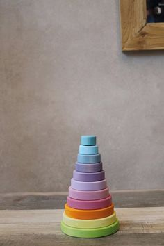 Large conical tower with 10 discs for stacking, sorting and plugging. Lime wood, non-toxic water based color stain. Ages We sincerely apologize, but this product is only available for sale within the United States. Natural Toys, Grimm, Pastel Colors, Tower, Rainbow, Sorting, Nest, United States, Wood