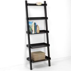 The Container Store > Java Linea Leaning Bookcase - fits in small space without being too obtrusive.