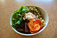Salad of spinach, roasted beets, olives, artichoke, lentils, sweet potato, and feta