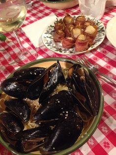 Fresh mussels with garlic, butter, and white wine tossed linguine.. bacon wrapped sea scallops as an appetizer.