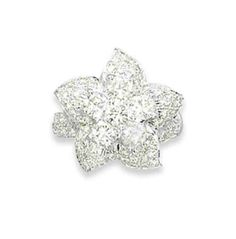 A DIAMOND FLOWER RING Pavé-set diamond flowerhead ring part of a suite encompassing a necklace, brooch, pair of ear pendants and this ring  | Christie's