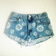 Buy stencils from michaels and spray paint any design onto old jean shorts