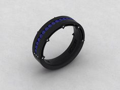 This is a Mens Band in 14kt Gold Black Rhodium band with Natural FSI1 Diamonds and Lab Created Sapphire. This band width is 5.8mm and can be
