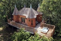 """The French tree house """"Monbazillac,"""" a shingled interpretation of the original Chateau de Monbazillac in southwestern France, sleeps two and..."""