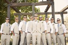 Light colored suits, perfect for a garden wedding
