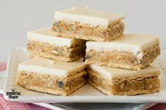 This classic recipe comes from our Homemade Good News cookbook series. A graham cracker crust with a buttery coconut and walnut center and vanilla icing topping. These bars have been a favorite for generations. Graham Cracker Dessert, Graham Cracker Recipes, Graham Cracker Cookies, Graham Cracker Crumbs, Graham Crackers, Cookie Recipes, Dessert Recipes, Bar Recipes, Snacks