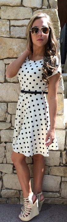 """Darling dot print dress. Belt included. Length: 34"""". 96% Polyester, 4% Spandex. Made in USA."""