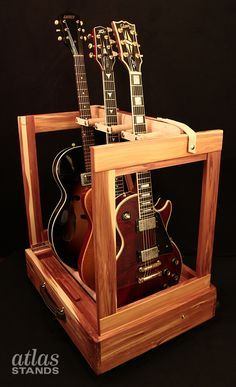 Atlas Triple Guitar Stand - Eastern Red Cedar - With two storage compartments for cables, capos, etc. www.atlas-stands.com http://atlas-stands.com/atlas-stands-hardwood-triple-guitar-stand/