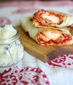 Healthy Chicken Parmesan Wraps: 1 cooked chicken breast, cut into strips 1/4 cup marinara or spaghetti sauce 1/8 cup shredded mozzarella cheese 1/8 cup parmesan cheese 1/8 tsp Italian spice blend 1 large low carb or whole grain wrap Optional: 1/2 cup baby spinach leaves