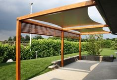 Fantastic Wooden Pergola Kits Design With Stone Floor And Garden In The Near Also Green Grass In Backyard Fantastic Wooden Pergola Kits Design for Decorating the Outdoor Area Home decoration