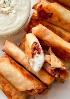 Baked Buffalo Chicken Eg Rolls. They turn out crispy-crunchy and way, way healthier than frying (like only about 100 calories each, healthy).  These buffalo chicken egg rolls are seriously perfect…and whether you eat a couple for a light lunch, for dinner with a salad, or serve them for a snack at your next party, you absolutely cannot go wrong.