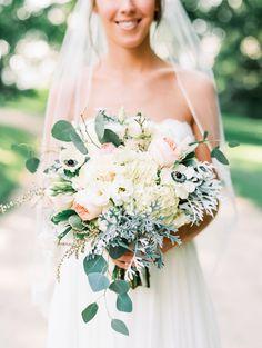 Rustic Anemone and Ranunculus filled wedding bouquet: Photography: Krista A. Jones - kristaajones.com