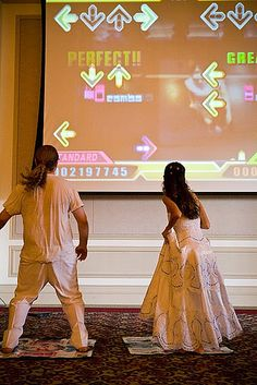 "Have access to a big projection screen or a big white wall? Instead of using it for a slideshow, use it for epic video game fun that most people can't get at home on their small screens. In Anie and Andrew's case, it's giant Dance Dance Revolution as their ""first dance."""