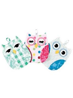 """Darling owl sewing patterns for pot holders will make your kitchen a hoot!   Hot Who Pot Holder Pattern includes full-size pattern pieces to sew up darling owl hot pads.  You could make a matching set of pot holders. Or mix it up with 3 different styles to choose from.  Each easy sewing pattern is quick-to-stitch and functionally fun! Finished size is 9"""" x 7"""" using 1 fat quarter for each owl body, plus yardage and scraps for the rest."""