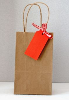 "Kraft Brown Gift Bags This listing is for 10 small kraft paper gift bags with handles. Great for party favors or small gifts. Adorable embellished or as is. Size: 5 1/4"" wide x 3 1/4"" deep x 8 1/2"" high Handle Measures approximately 4 1/4"" Ribbon and tag not included."