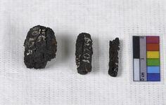 Photographs of three of the originally nine iron beads from Gerzeh, Lower Egypt. ...