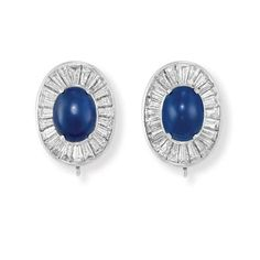 Pair of Cabochon Sapphire and Diamond Earclips, Van Cleef & Arpels   Platinum, centering 2 oval cabochon sapphires approximately 8.50 cts., surrounded by 48 tapered baguette diamonds approximately 4.25 cts., with concealed pendant wires, signed Van Cleef & Arpels NY, # 473150, approximately 10.5 dwt.