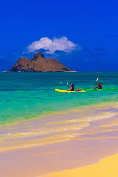 Sea kayaking, Lanikai Beach, Moku Lua Island in background, Oahu, Hawaii, USA
