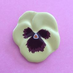 "Vintage Avon ceramic pansy pin Perfect for spring on a lapel, hat or scarf. Yellow with a purple center. No chips. About 1.75"" tall and 1.5"" wide. Price firm unless bundled. Avon Jewelry Brooches"