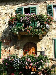 balcony, one of the things I found so enchanting about Italy. Balcony's covered in flowers.