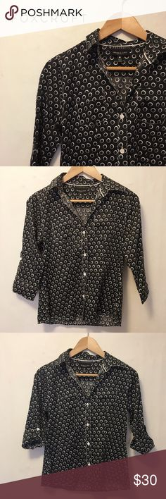 NWOT Printed blouse -- wrinkle free! Never worn printed blouse from Foxcroft. No signs of wear. Stretch material, in an excellent print. You can roll up the sleeves with a button. Please message me if you have any questions! Foxcroft Tops Button Down Shirts