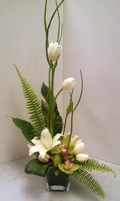 Orchids, tulips, and lilies creating a beautiful monochromatic design. Contemporary Flower Arrangements, Tropical Floral Arrangements, White Flower Arrangements, Creative Flower Arrangements, Artificial Floral Arrangements, Ikebana Arrangements, Ikebana Flower Arrangement, Deco Floral, Arte Floral