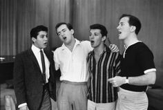 (L-R) Paul Anka, Bobby Darin, Frankie Avalon and Pat Boone singing together at a rehearsal. Photograph by Peter Stackpole. New York City, June 1960.