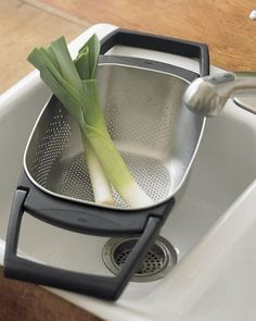 A colander that I can suspend across the sink: excellent.  And look at that magnificent leek!  $35.