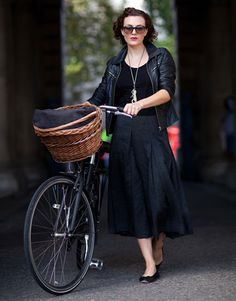 Woman with bike from Harpers Bazaar