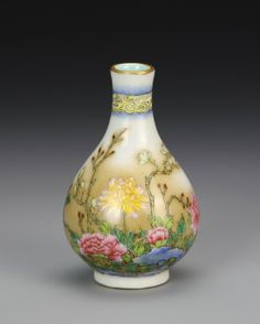 China, 19th C., miniature Famille Rose vase, with footed base, white ground color, with gilted line encircling rim, band of vivid yellow and blue auspicious symbols, vibrantly colored floral motif with calligraphy signature and red seals on body, with Qianlong mark.