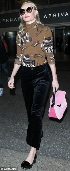Strange colour choice: The 32-year-old co-ordinated with a pink handbag that clashed with her outfit