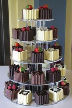 Individual wedding cakes in white, milk & dark chocolate mini cakes - from www.devineweddingcakes.com