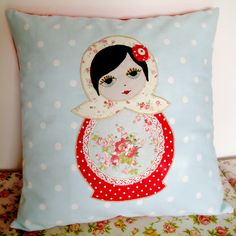 The prettiest face on this matroyshka pillow.