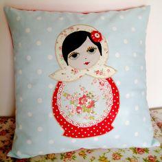 The prettiest face on this matroyshka pillow.