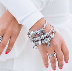 Contrast the rising temperatures with a cool, all-white PANDORA style. Stack florals, garden-themed charms, butterflies, and lacy charms for a glamorous, feminine look. #PANDORATexas #PANDORAbracelets #PANDORArings