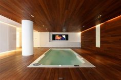 An indoor Pool Room with matching panels, all around.