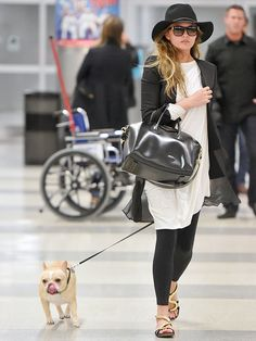 Star Tracks: Monday, January 5, 2015 | TOP DOG | Model Chrissy Teigen hides in plain sight with her pup Pippa at JFK airport in New York City on Sunday.