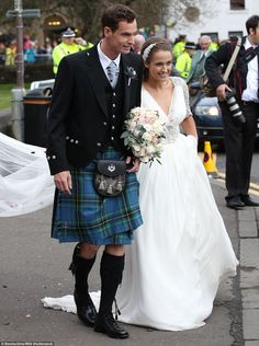 It's official, we're spliced! Andy and his bride make their way out of Dunblane Cathedral ...