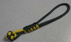 Paracord lanyard with snake and clover knots.