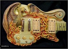 """A hand-carved guitar by Doug Rowell, """"Golden Girl Telecaster,"""" is a 1973 Fender Telecaster that was left for dead after being run over by…"""